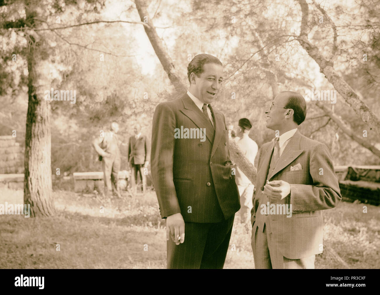 Reception by the Director of Programmes, Palestine Broadcasting Service. Mr. Lababidi and Ibrahim Toukan. 1940 - Stock Image