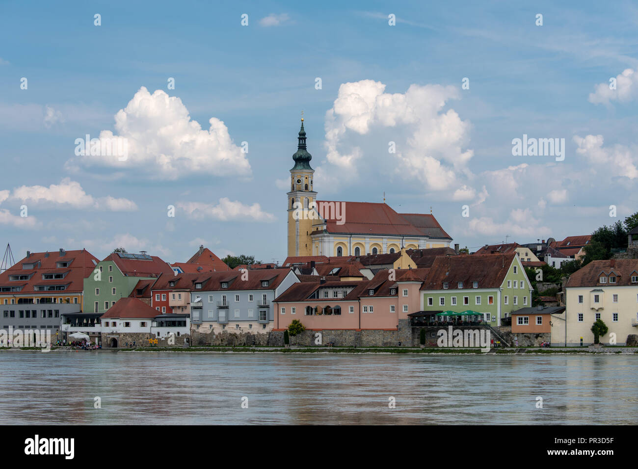 Quaint church and town as seen from Danube River Stock Photo