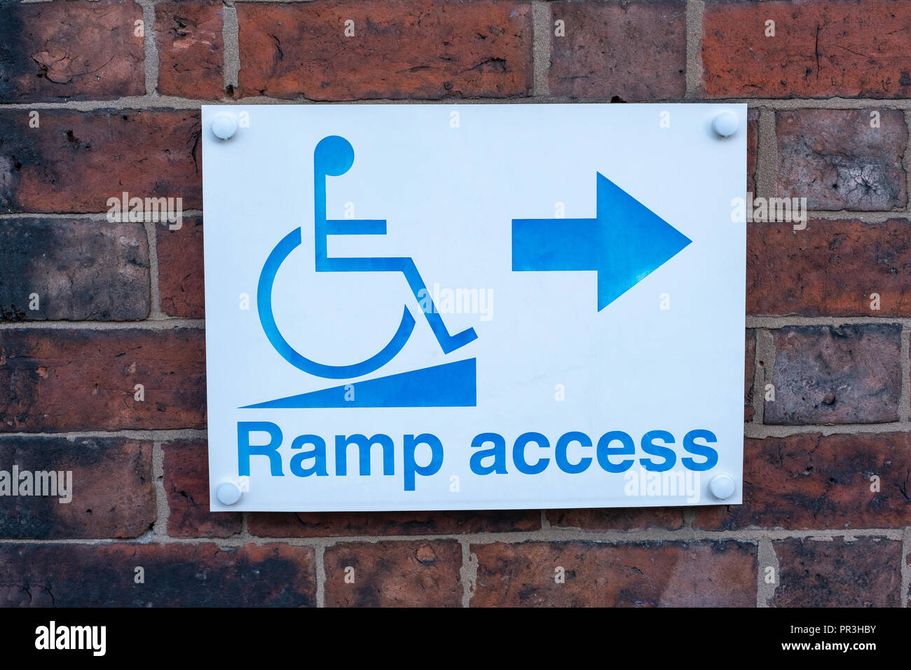 Ramp access sign on outside wall UK - Stock Image