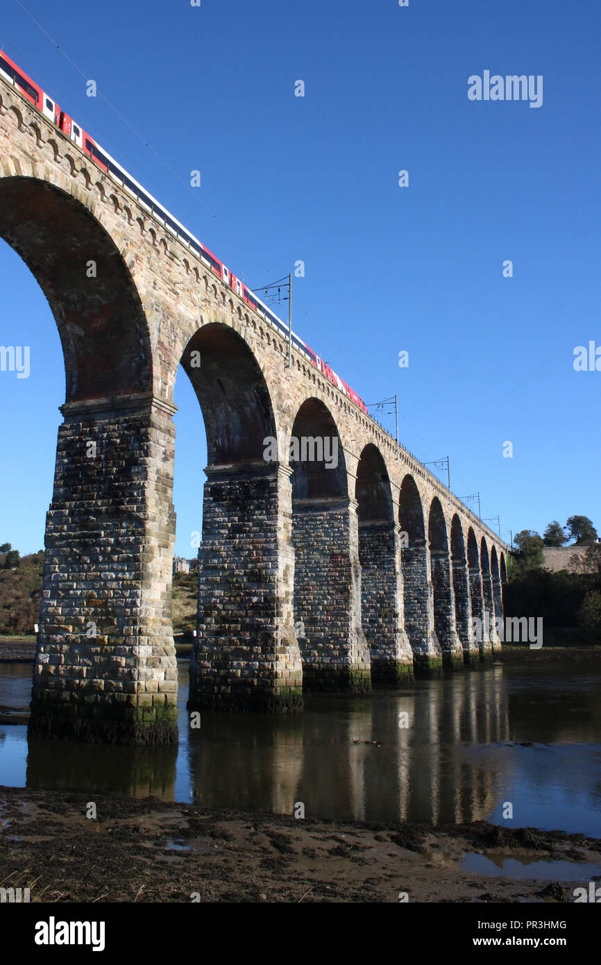 Class 91 electric loco on ECML with LNER passenger train crossing Royal Border Bridge over River Tweed at Berwick-upon-Tweed on 28th September 2018. - Stock Image