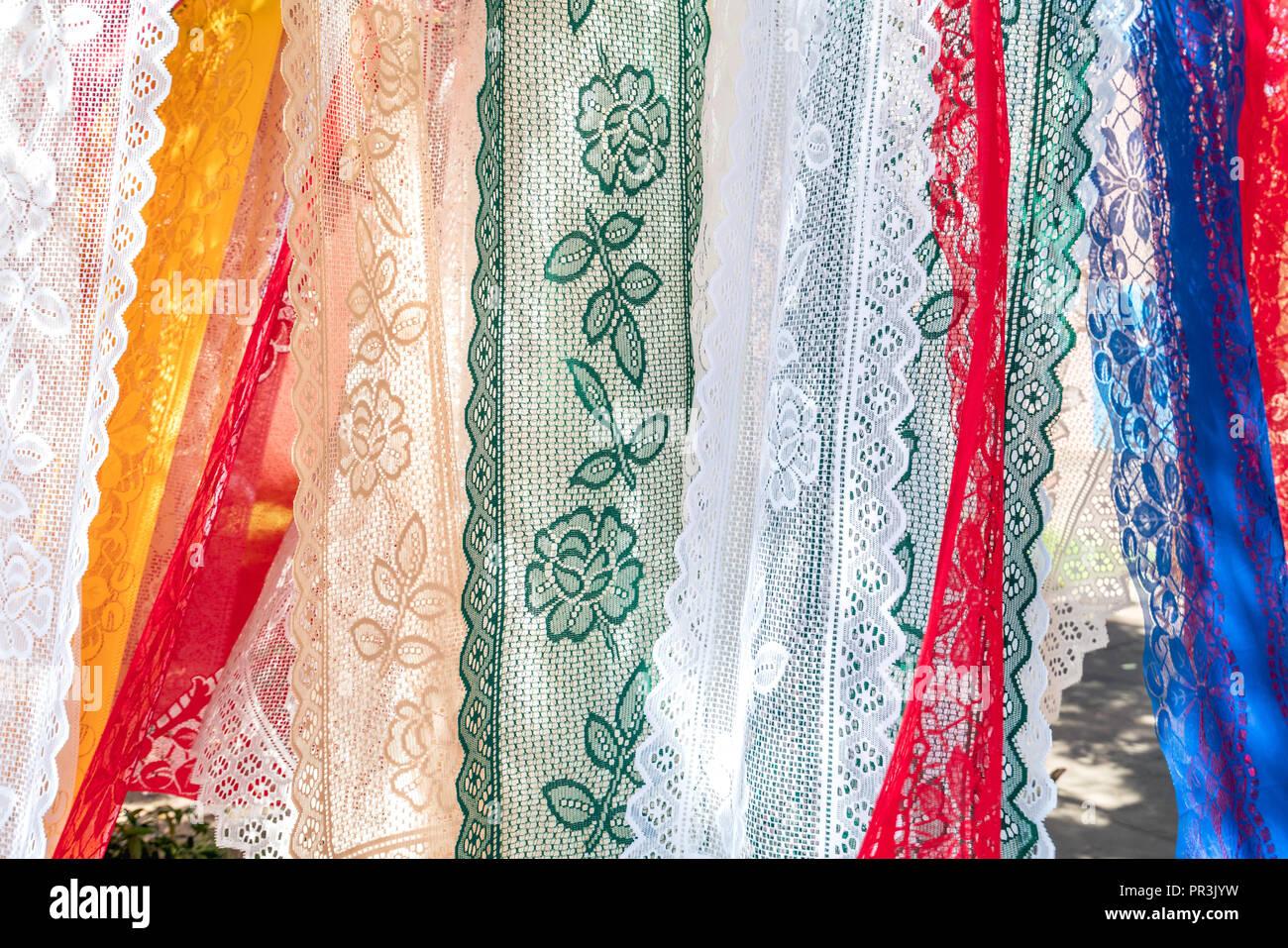 Colorful lace towels in the air, in Olinda, Pernambuco, Brazil - Stock Image