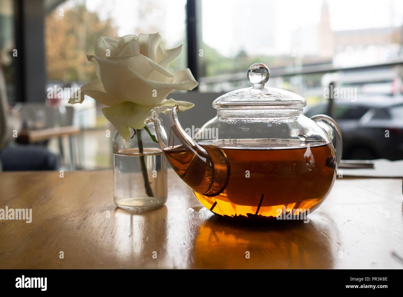 White Rose Next To Fancy Tea Pot Stock Photo Alamy