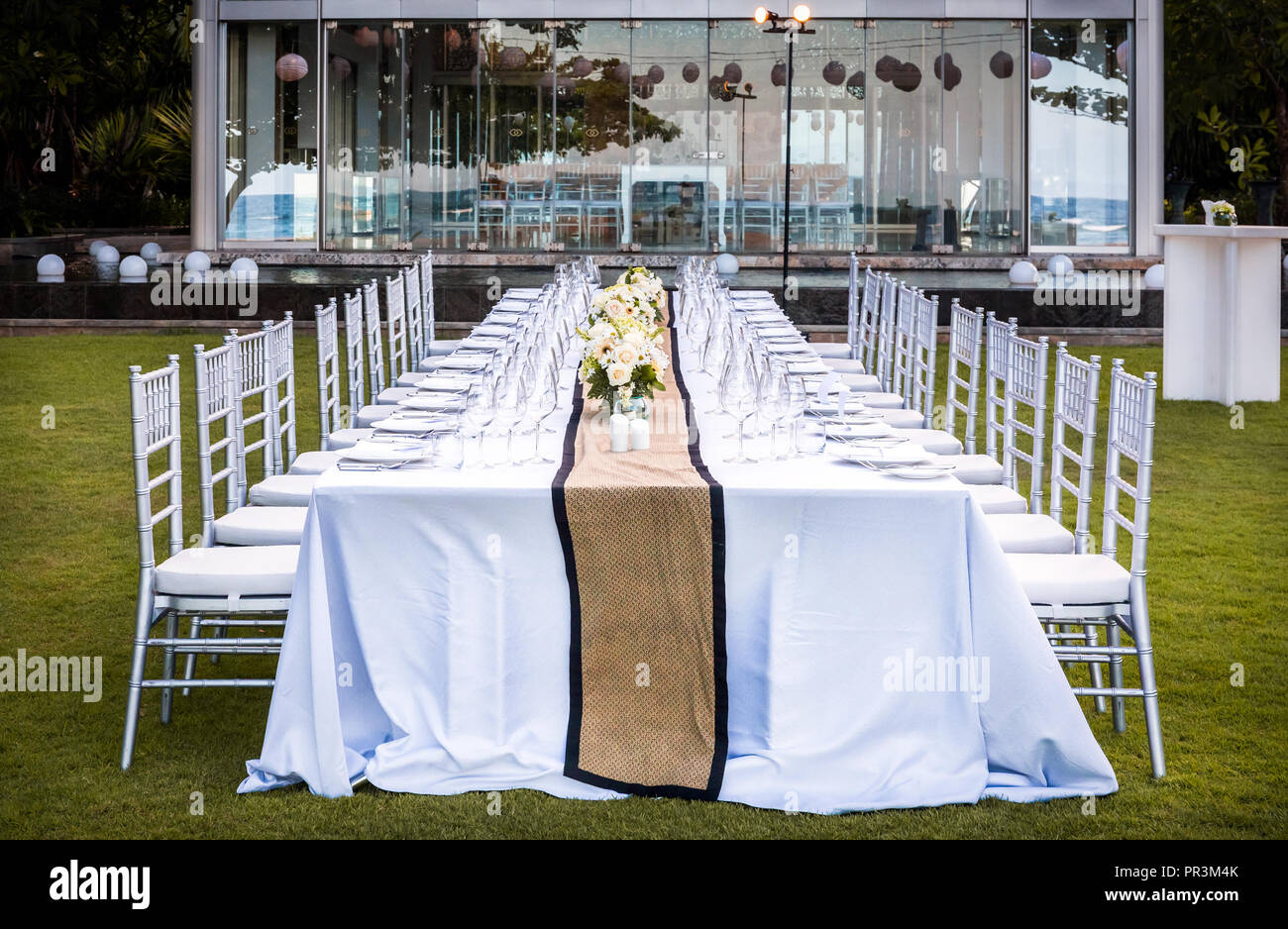 Chairs and table prepared for garden party Stock Photo - Alamy