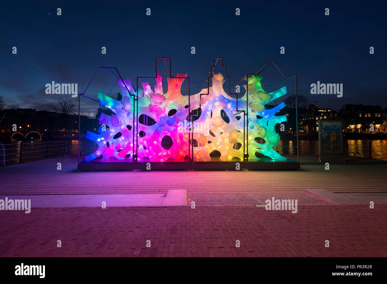 Amsterdam, Netherlands, Amstel during Amsterdam Light Festival with colour changing artwork 'Rhizome House'of 'DP Architects'  in stunning colours. - Stock Image