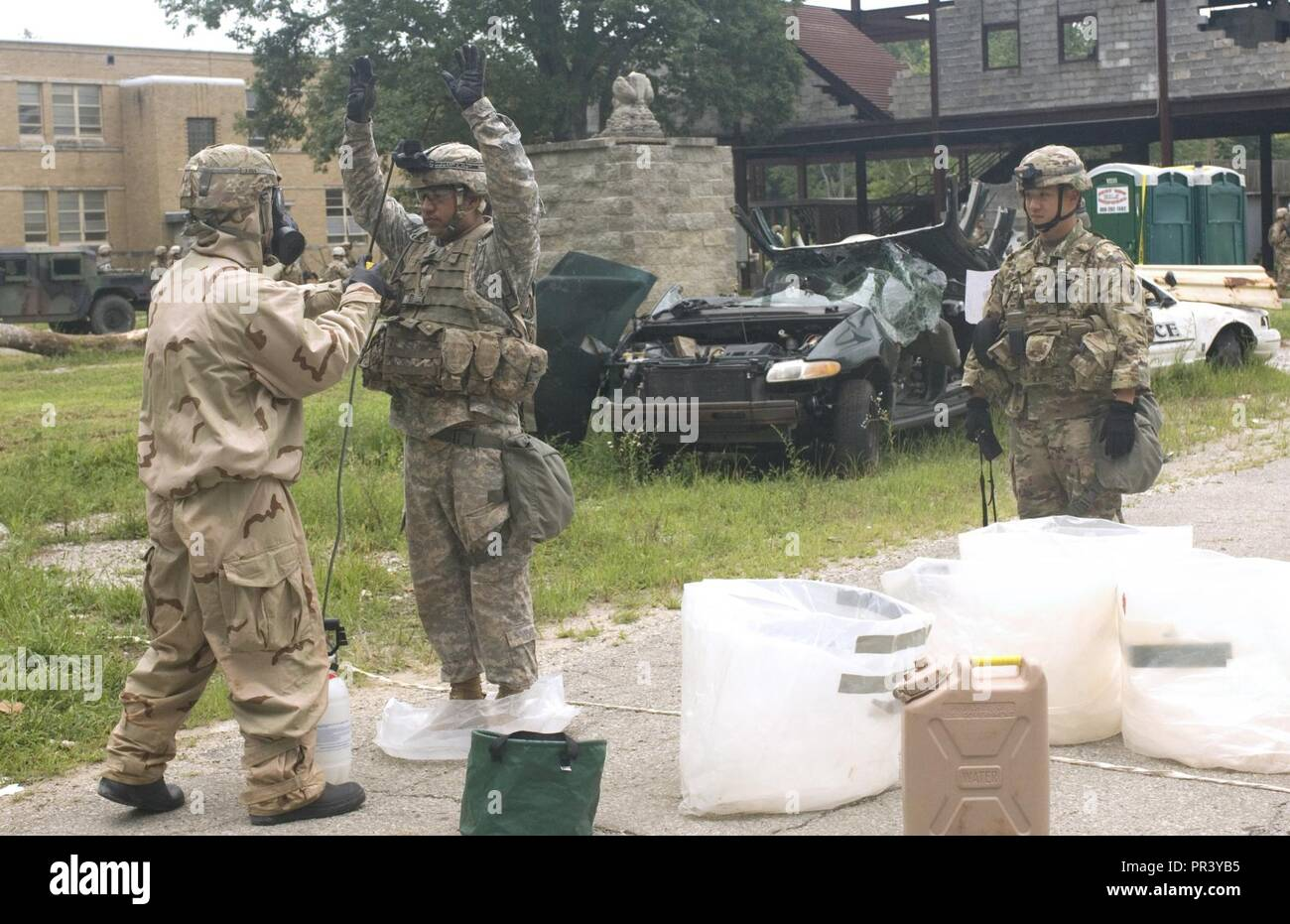 US Army Soldiers Assigned To The 65th Brigade Engineer Battalion BEB 2nd Combat Team 25th Infantry Division Simulate Decontamination