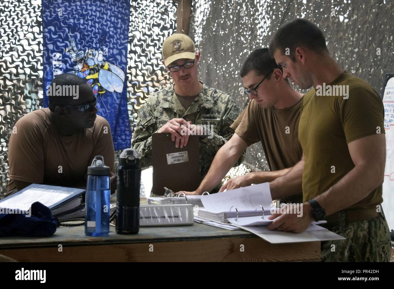CAMP LEMMONIER, Djibouti (July 27, 2017) Sailors assigned to Coastal Riverine Squadron (CRS) 1, review maintenance procedures in preparation for an upcoming inspection at Camp Lemonnier, Djibouti. Coastal riverine force are a core Navy capability that provides high value asset protection and maritime security operations in coastal and inland waterways. Stock Photo