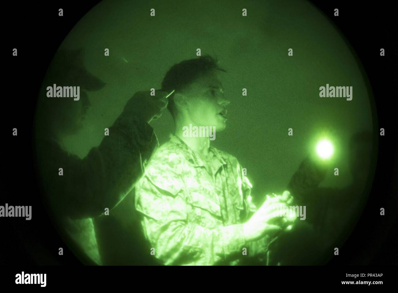 U.S. Marine Corps Sgt. Pawel Cabaj, right, bust instructor, 2nd Marine Division, gives a class on PVS-14 night vision device during Career Orientated Training for Midshipmen (CORTRAMID) Marine Week, Camp Lejeune, N.C., July 25, 2017. The purpose of CORTRAMID is to expose students to opportunities in the Fleet Marine Forces and generate an interest in a Marine Corps commission. Stock Photo