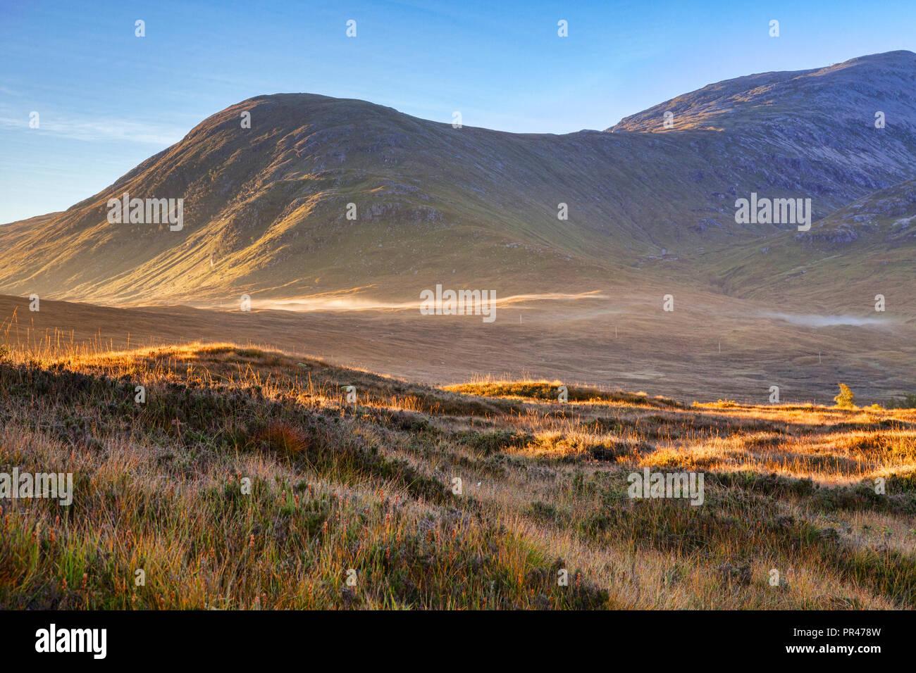 Glencoe at sunrise, in autumn, Lochaber, Highlands, Scotland, UK. - Stock Image