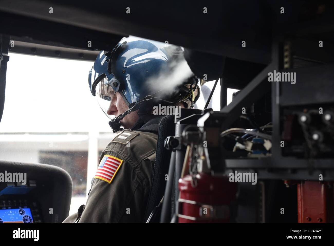 Coast Guard Lt. Kyle Johnson, a member of a flight crew from Clearwater, Florida, conducts preparation checks Saturday, Sept. 15, 2018, before departing Coast Guard Air Station Savannah. The air crew flew an MH-60 Jayhawk helicopter over Myrtle Beach, South Carolina to assess the damage and flooding from Hurricane Florence. Stock Photo