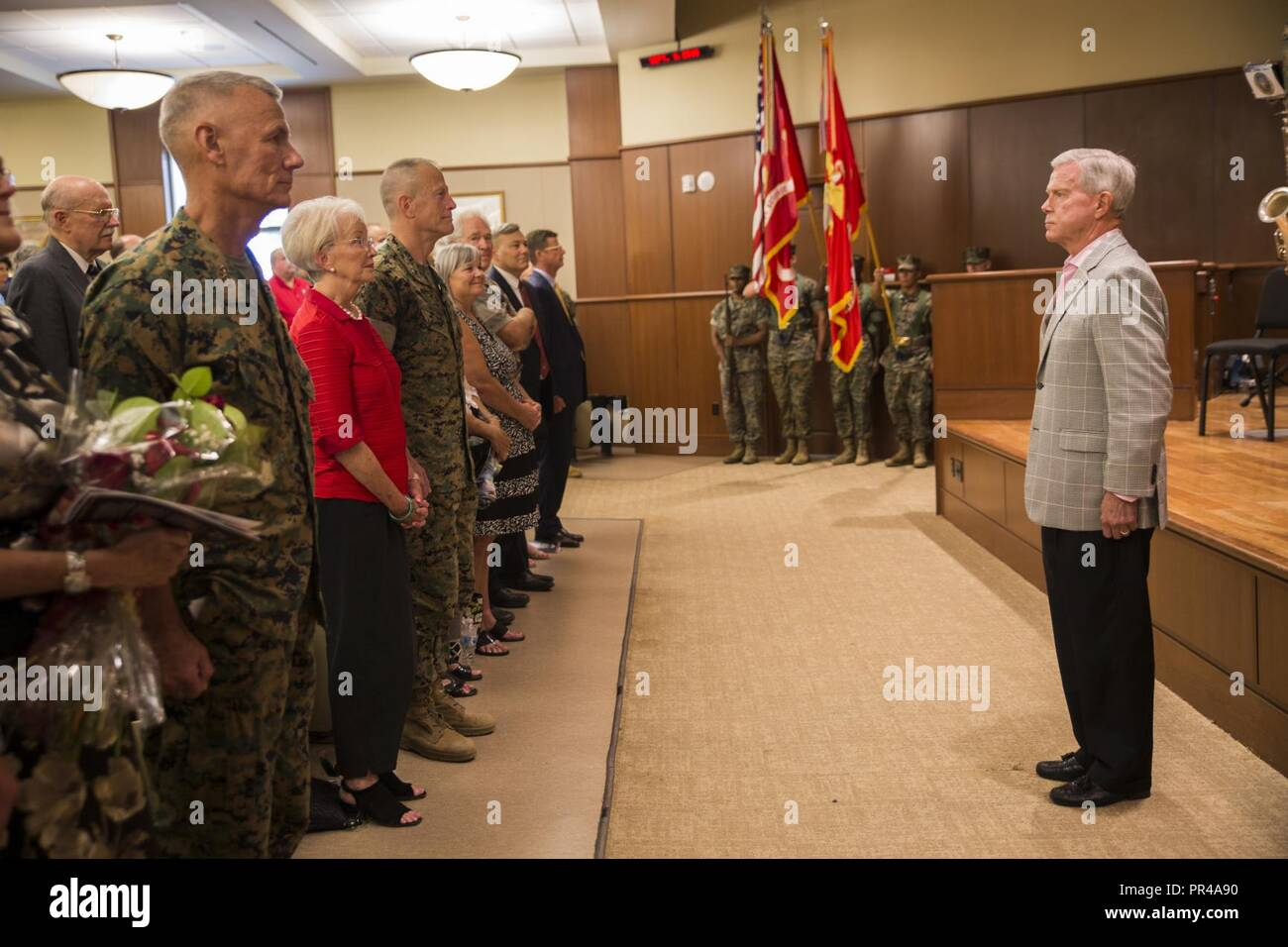 Retired Marine Gen. James F. Amos, 35th Commandant of the Marine Corps, stands at attention as colors are presented in his honor at Marine Corps Support Facility New Orleans, Sept. 8, 2018. Amos was the retiring officer for Lt. Gen. Rex C. McMillian, outgoing commander of Marine Forces Reserve and Marine Forces North. Stock Photo