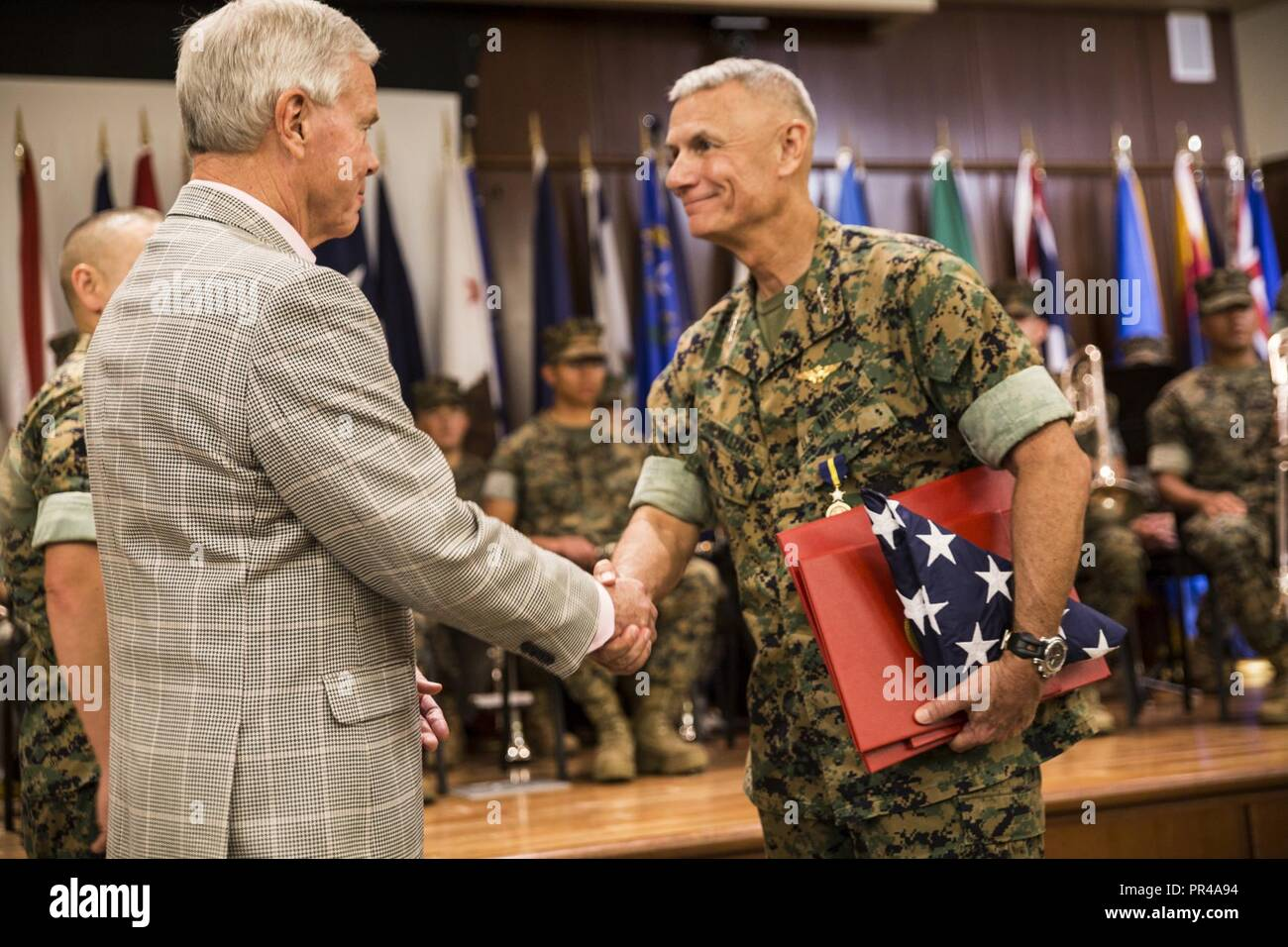 Retired Marine Gen. James F. Amos, 35th Commandant of the Marine Corps, shakes the hand of Lt. Gen. Rex C. McMillian, outgoing commander of Marine Forces Reserve and Marine Forces North, at Marine Corps Support Facility New Orleans, Sept. 8, 2018. Amos was the retiring officer for McMillian, who served almost 40 years in the Marine Corps. Stock Photo