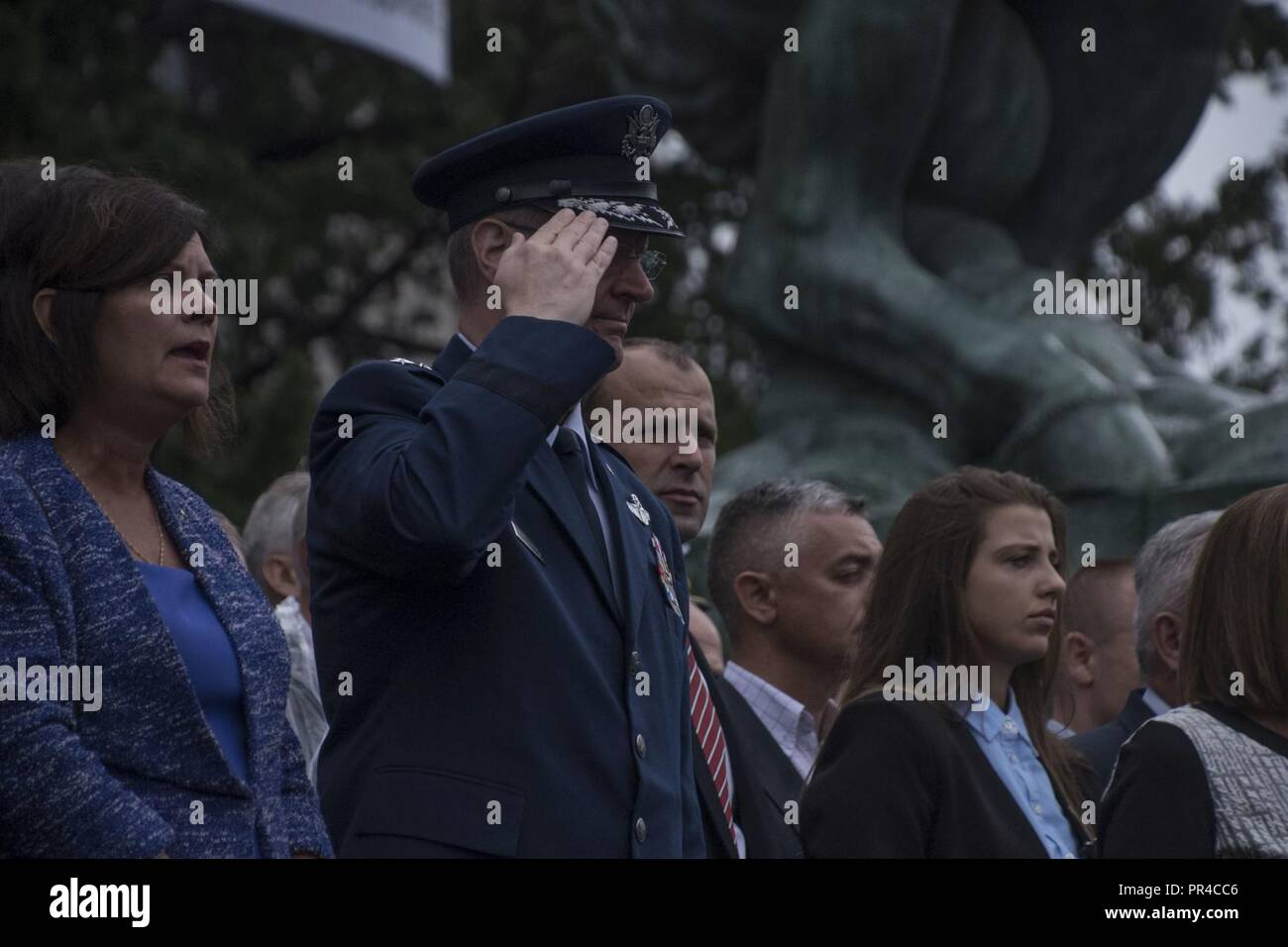 Officer cadets from the Military Academy take part in a graduation ceremony in front of the National Assembly of the Republic of Serbia Sept. 8, 2018, in Belgrade, Serbia. An Ohio National Guard delegation, led by Maj. Gen. Mark E. Bartman (saluting), Ohio adjutant general, was in Serbia for CAPSTONE 2018, the annual culmination of the year's events to highlight the Serbian-Ohio National Guard pairing through the Department of Defense State Partnership Program. Also on the trip was South Euclid, Ohio Mayor Georgine Welo (left), who was there to sign a Sister Cities International memorandum of  - Stock Image