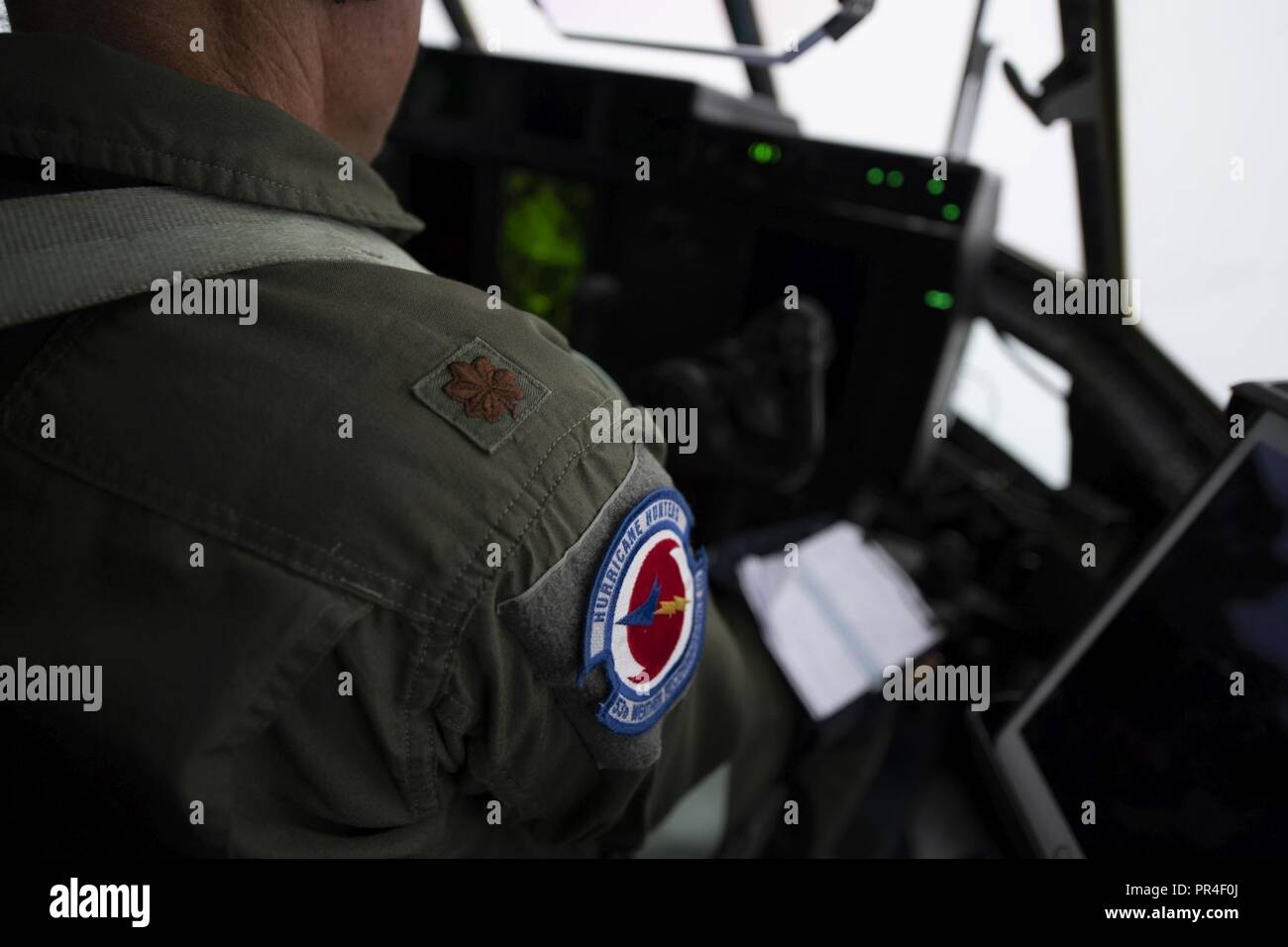 The Hurricane Hunter patch on the right arm of Major Stephen Pituch. The HC-130J that he flys took off from Savanah Air National Guard Base, Savanah, GA Airport, September 12, 2018. The U.S. Air Force Reserve 53rd Weather Reconnaissance Squadron, or Hurricane Hunters, is conducting a storm tasking mission into Hurricane Florence, currently a category 4 storm. The tasking provides critical and timely weather data for the National Hurricane Center to assist in providing up-to-date and accurate information for storm forecasts. - Stock Image