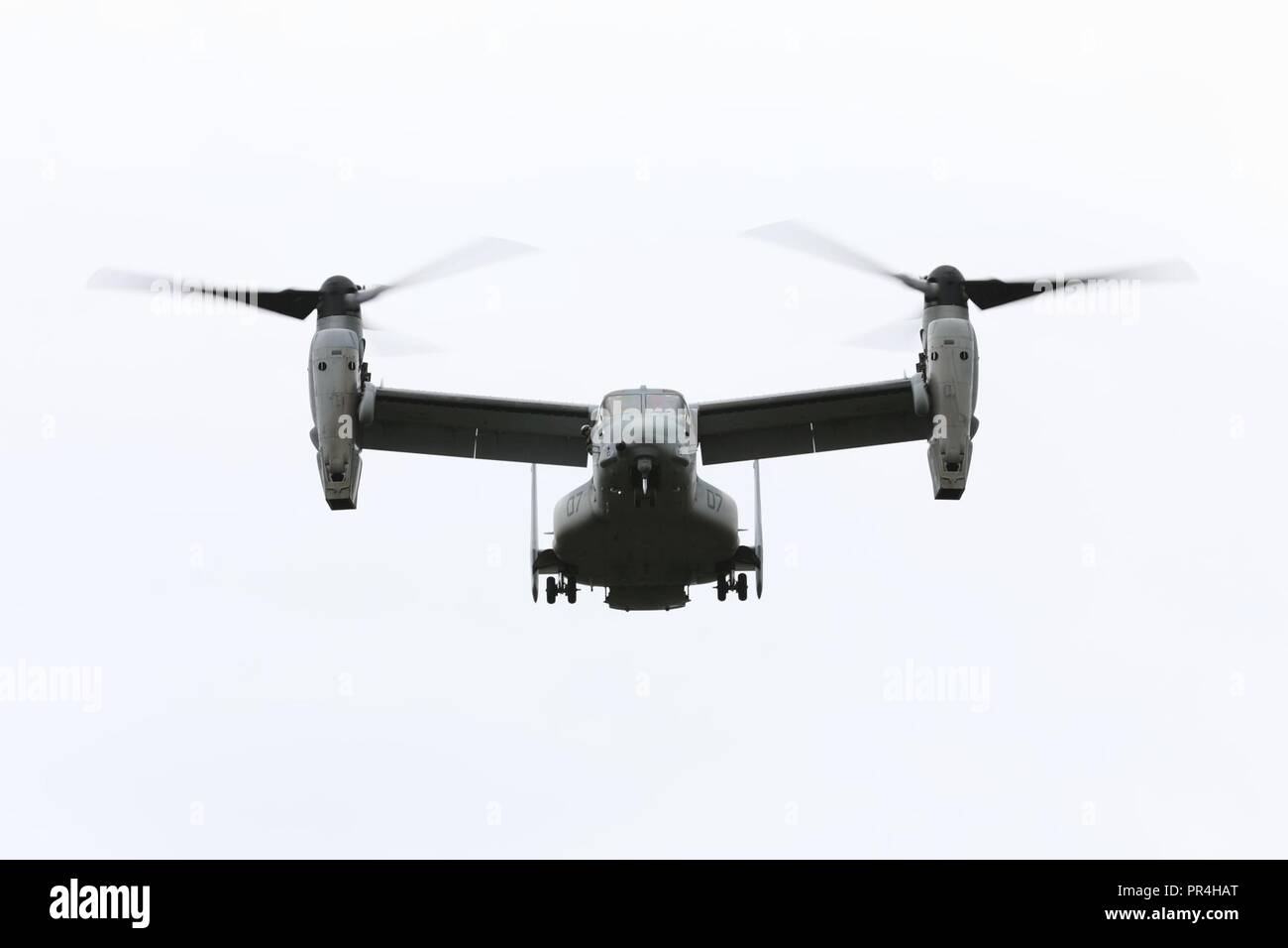 An MV-22 Osprey assigned to Marine Medium Tiltrotor Squadron 363 (VMM-363), conducts a confined area landing exercise on near the Kahuku Training Area, Sept. 13, 2018. The training provided an opportunity for pilots and crew chiefs to improve their proficiency and experience in flying around a tropical environment. Stock Photo