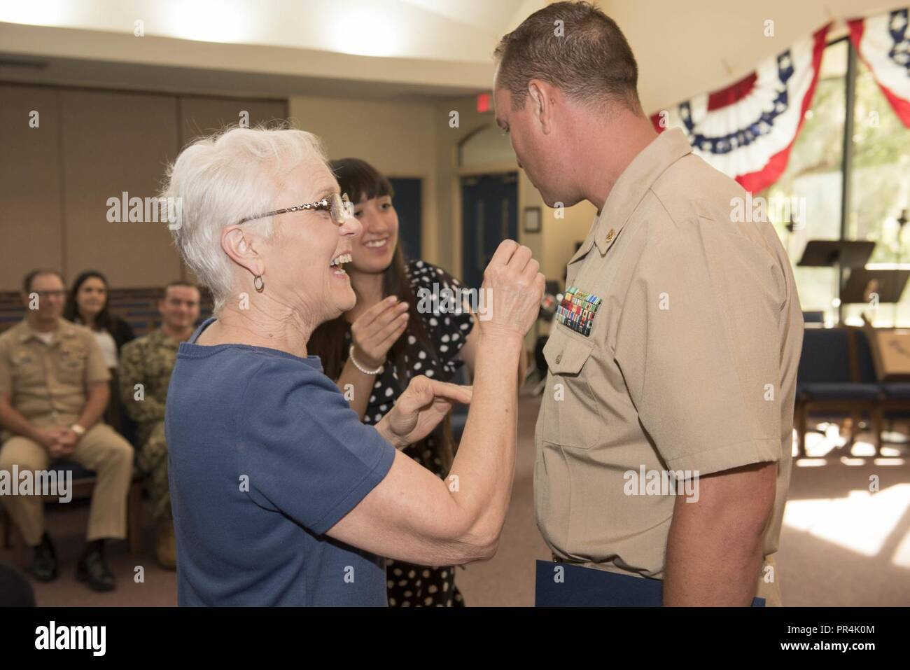 KINGS BAY, Georgia (Sept. 14, 2018) Chief Master at Arms Joshua Vanorder is pinned with his anchors by his family during Naval Submarine Base Kings Bay's 2018 chief petty officer pinning ceremony.  The base is home to six of the Ohio-class ballistic-missile submarines that make up the most survivable leg of the nuclear missile triad. - Stock Image