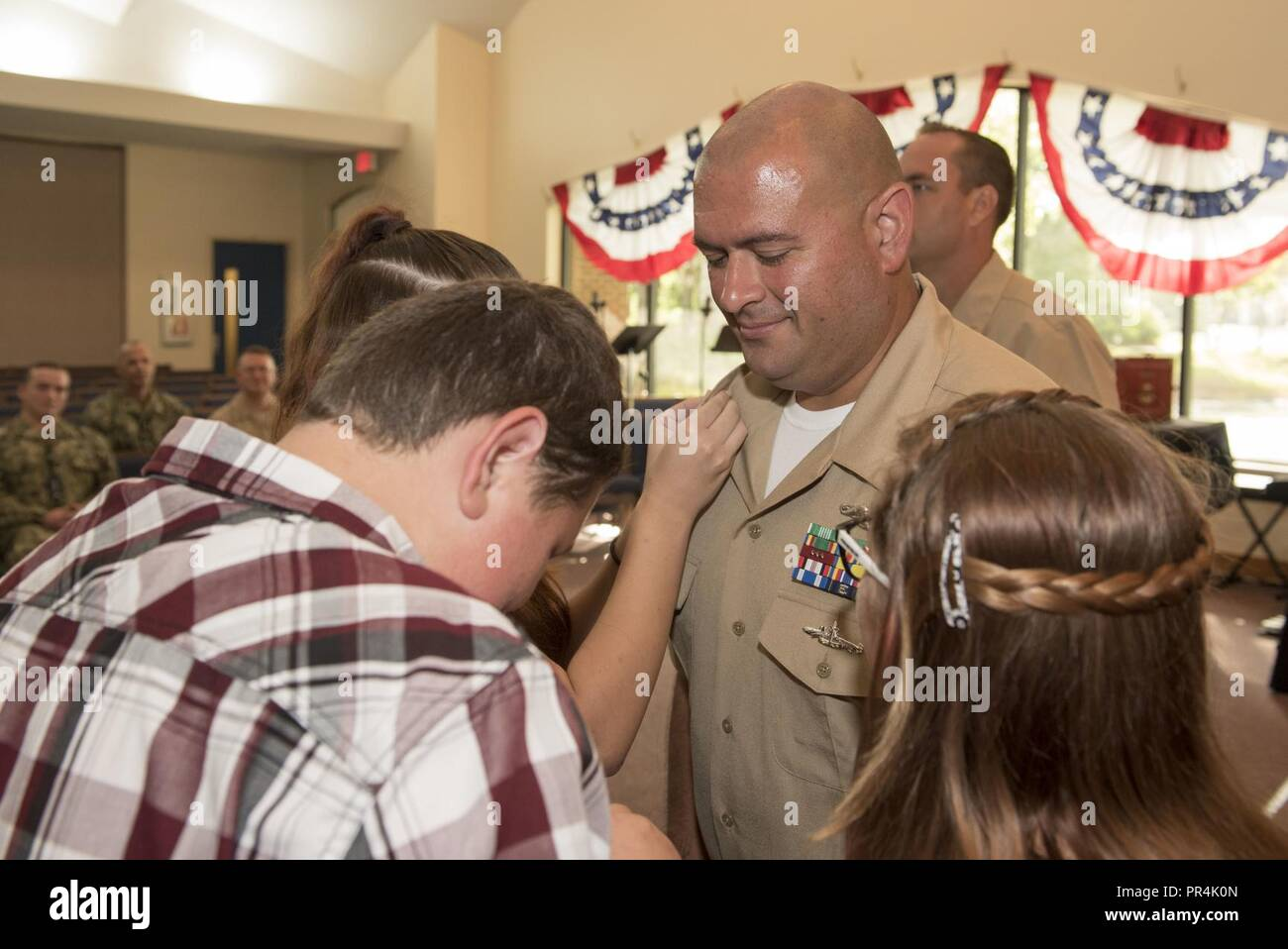 KINGS BAY, Georgia (Sept. 14, 2018) Chief Culinary Specialist (Submarines) John Nordman is pinned with his anchors by his family during Naval Submarine Base Kings Bay's 2018 chief petty officer pinning ceremony.  The base is home to six of the Ohio-class ballistic-missile submarines that make up the most survivable leg of the nuclear missile triad. - Stock Image