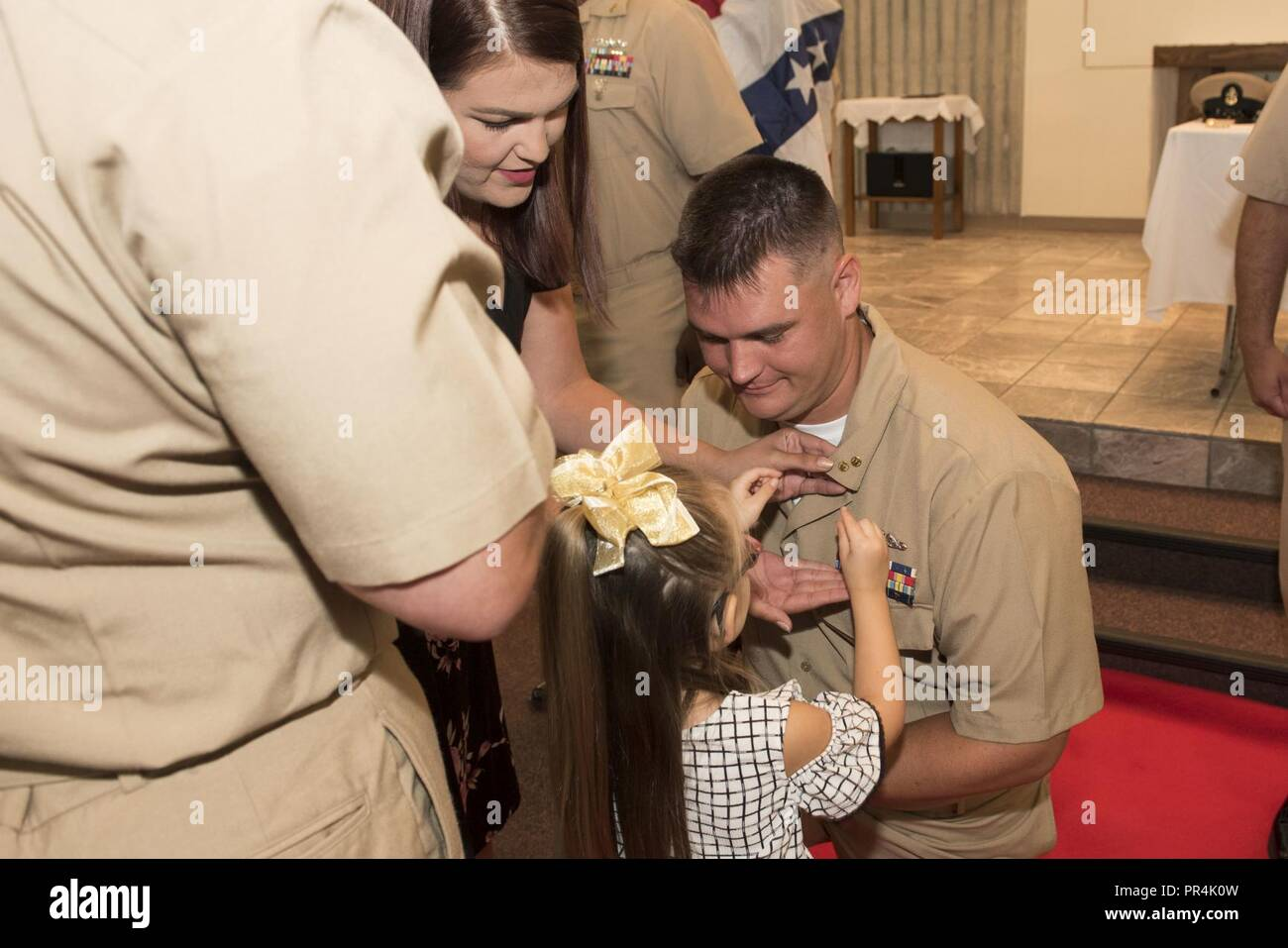 KINGS BAY, Georgia (Sept. 14, 2018) Chief Culinary Specialist (Submarines) Seth Smith is pinned with his anchors by his family during Naval Submarine Base Kings Bay's 2018 chief petty officer pinning ceremony.  The base is home to six of the Ohio-class ballistic-missile submarines that make up the most survivable leg of the nuclear missile triad. - Stock Image