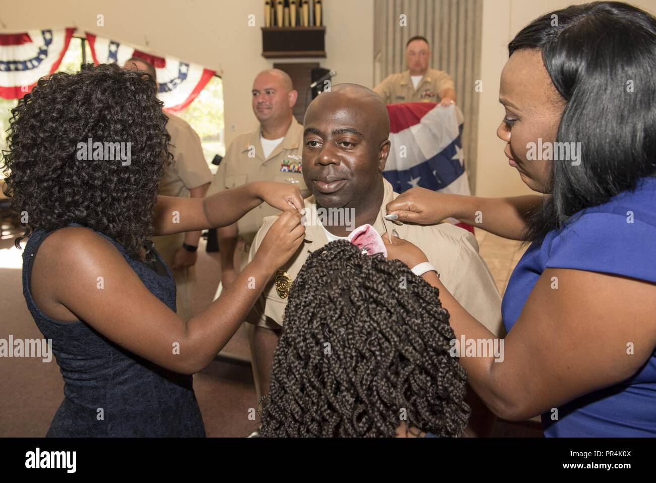 KINGS BAY, Georgia (Sept. 14, 2018) Chief Master at Arms Alvin Jenkins Jr. is pinned with his anchors by his family during Naval Submarine Base Kings Bay's 2018 chief petty officer pinning ceremony.  The base is home to six of the Ohio-class ballistic-missile submarines that make up the most survivable leg of the nuclear missile triad. - Stock Image
