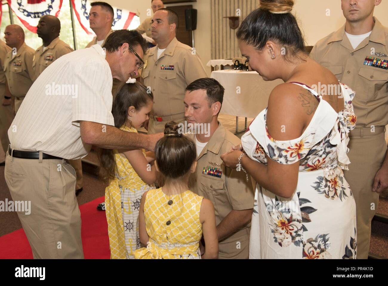 KINGS BAY, Georgia (Sept. 14, 2018) Chief Culinary Specialist (Submarines) Ryan Singleton is pinned with his anchors by his family during Naval Submarine Base Kings Bay's 2018 chief petty officer pinning ceremony.  The base is home to six of the Ohio-class ballistic-missile submarines that make up the most survivable leg of the nuclear missile triad. - Stock Image