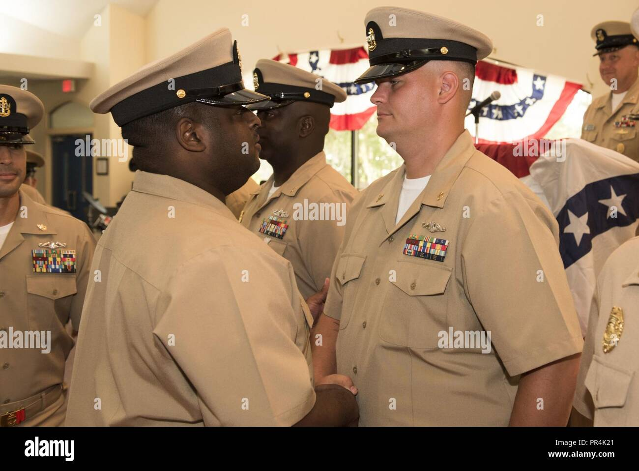 KINGS BAY, Georgia (Sept. 14, 2018) Chief Culinary Specialist (Submarines) Seth Smith is congratulated by his sponsor during Naval Submarine Base Kings Bay's 2018 chief petty officer pinning ceremony.  The base is home to six of the Ohio-class ballistic-missile submarines that make up the most survivable leg of the nuclear missile triad. - Stock Image