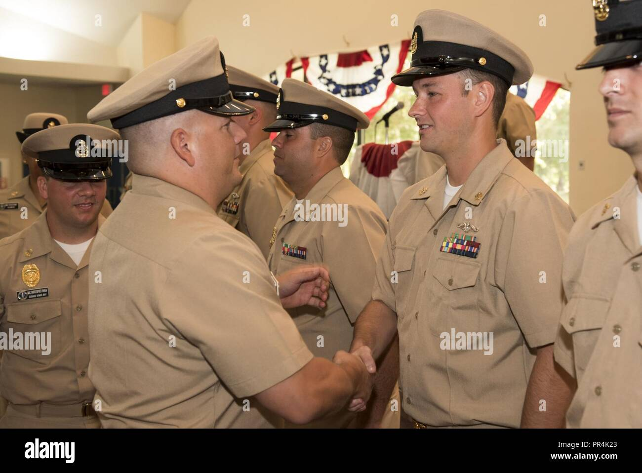 KINGS BAY, Georgia (Sept. 14, 2018) Chief Culinary Specialist (Submarines) Ryan Singleton is congratulated by his sponsor during Naval Submarine Base Kings Bay's 2018 chief petty officer pinning ceremony.  The base is home to six of the Ohio-class ballistic-missile submarines that make up the most survivable leg of the nuclear missile triad. - Stock Image