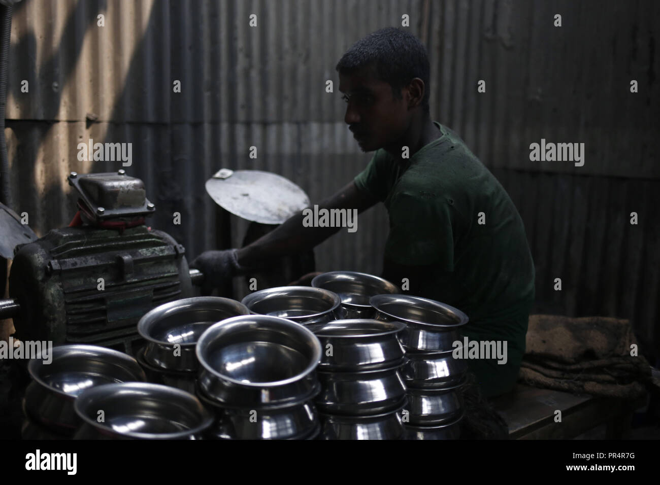 September 29, 2018 - Dhaka, Bangladesh - Steel made utensil factory worker works on a very hazardous environment for low wages. (Credit Image: © MD Mehedi Hasan/ZUMA Wire) - Stock Image