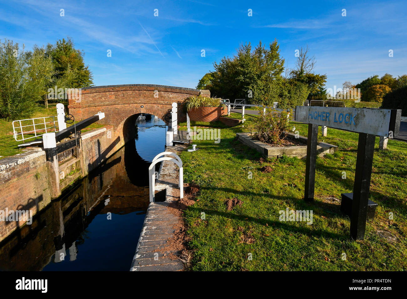 Uk Weather Higher Lock On The Bridgwater And Taunton Cnear Hedging In Somerset On A Day Of Sunshine And Clear Blue Skies