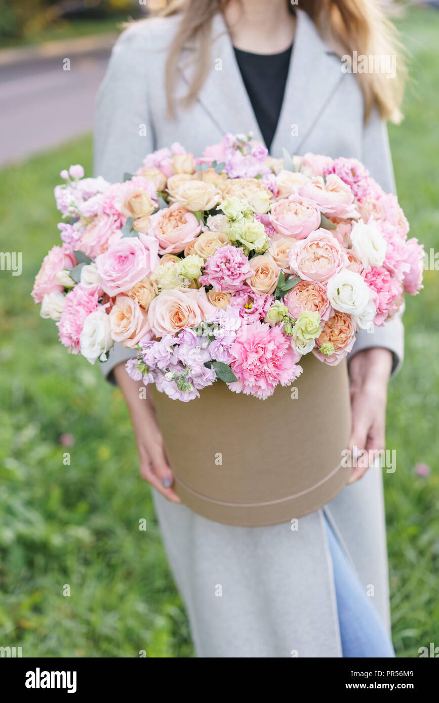 Beautiful spring bouquet in round box arrangement with various beautiful spring bouquet in round box arrangement with various flowers the concept of a flower shop a set of photos for a site or catalogue izmirmasajfo