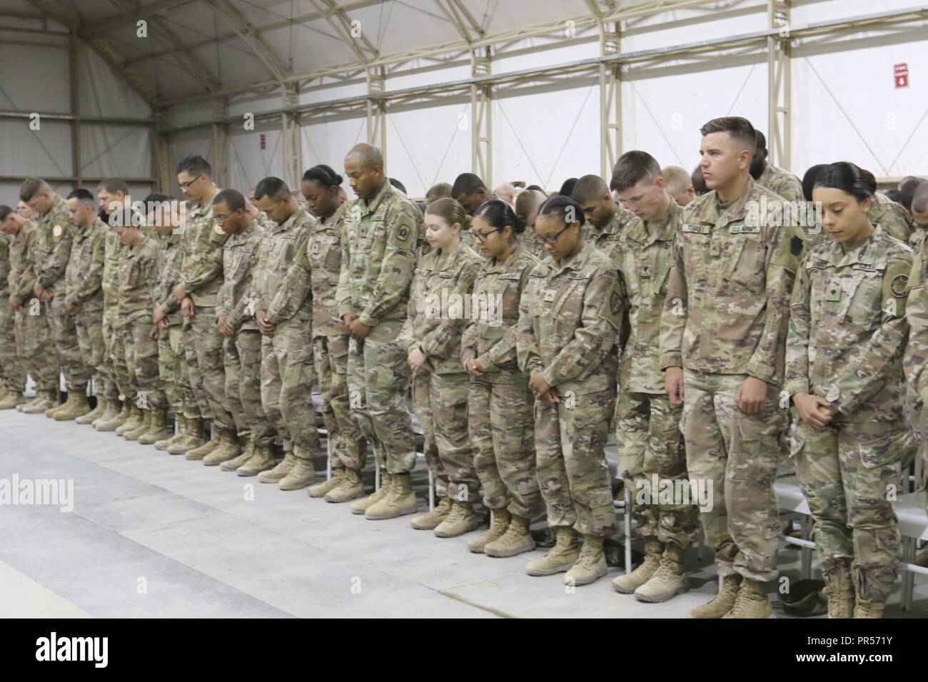 U S  Army Soldiers, during the benediction at the graduation