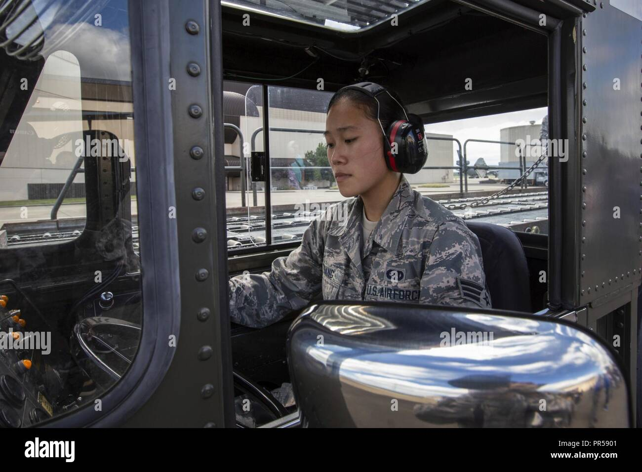 U.S. Air Force Senior Airmen Vince Tsang with the 88th Aerial Port Squadron, 514th Air Mobility Wing, operates a Tunner 60K aircraft loader/transporter at Joint Base McGuire-Dix-Lakehurst, N.J., Sept. 15, 2018. The 514th is an Air Force Reserve Command Unit. - Stock Image