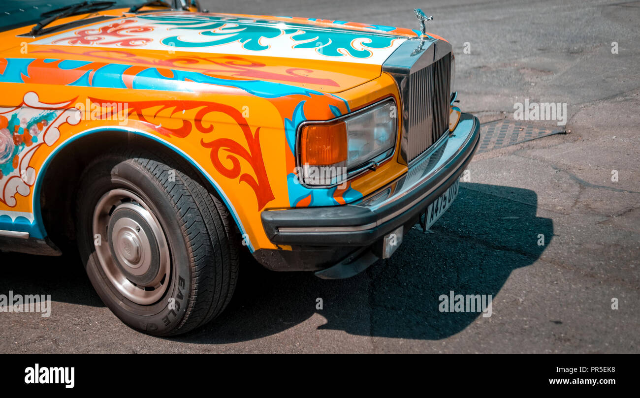 Painted Rolls-Royce car similar to John Lennon's Psychedelic Sgt. Pepper's Lonely Hearts Club Band Phantom Rolls-Royce from 1965 - Stock Image