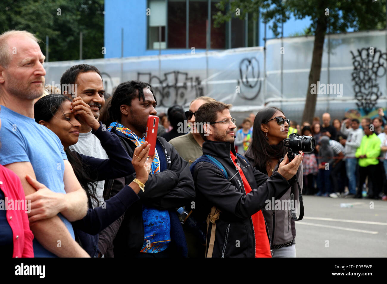 London, UK - August 27, 2018: Many spectators, audience and photographs happily greeted Notting Hill Carnival parade - Stock Image