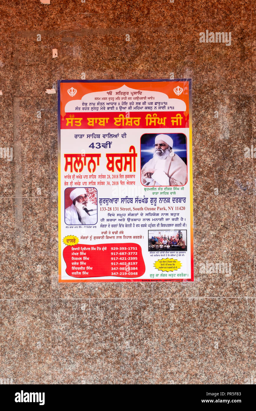 A Punjabi sign outside a Sikh temple in Richmond Hill announcing speeches in the neighborhood by respected religious leaders. In Queens New York City. - Stock Image