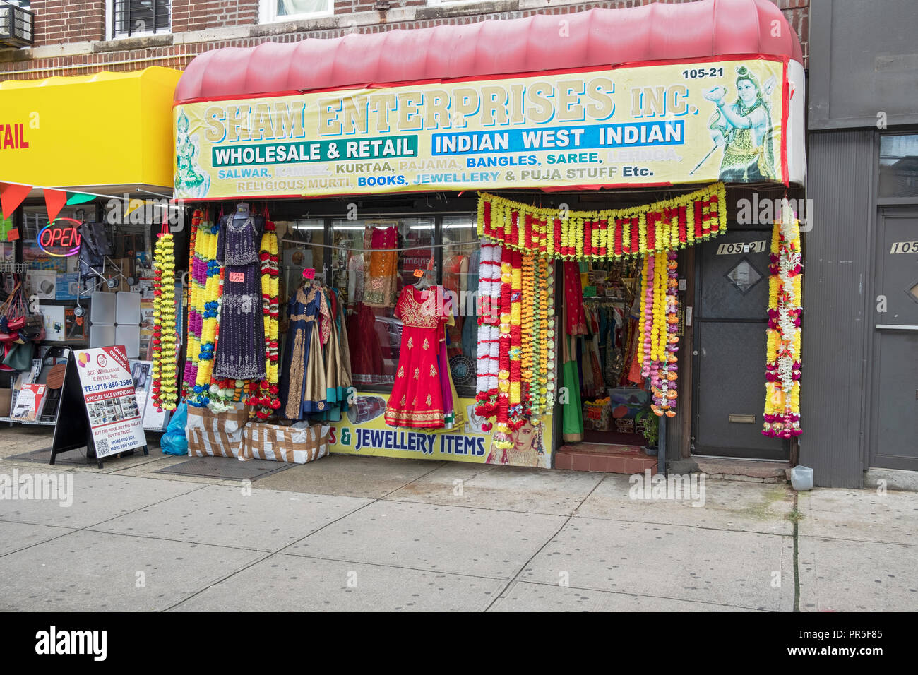 The exterior of SHAM ENTERPRISES INC., a store that sells Indian fashions  on Liberty Ave. in South Richmond Hill, Queens, New York City. - Stock Image