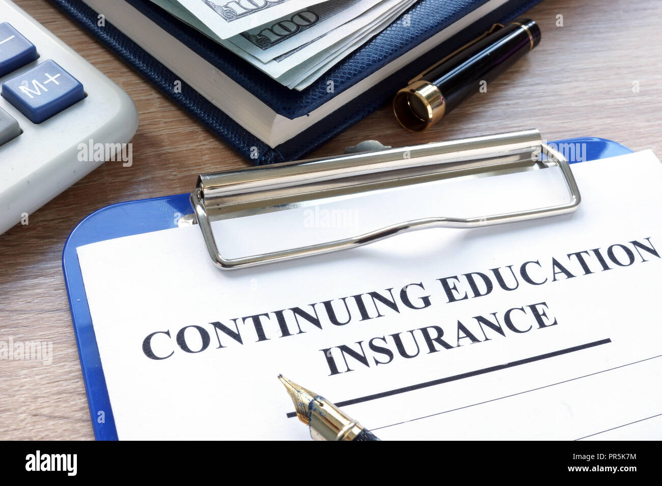Continuing Education Insurance policy and the pen. - Stock Image
