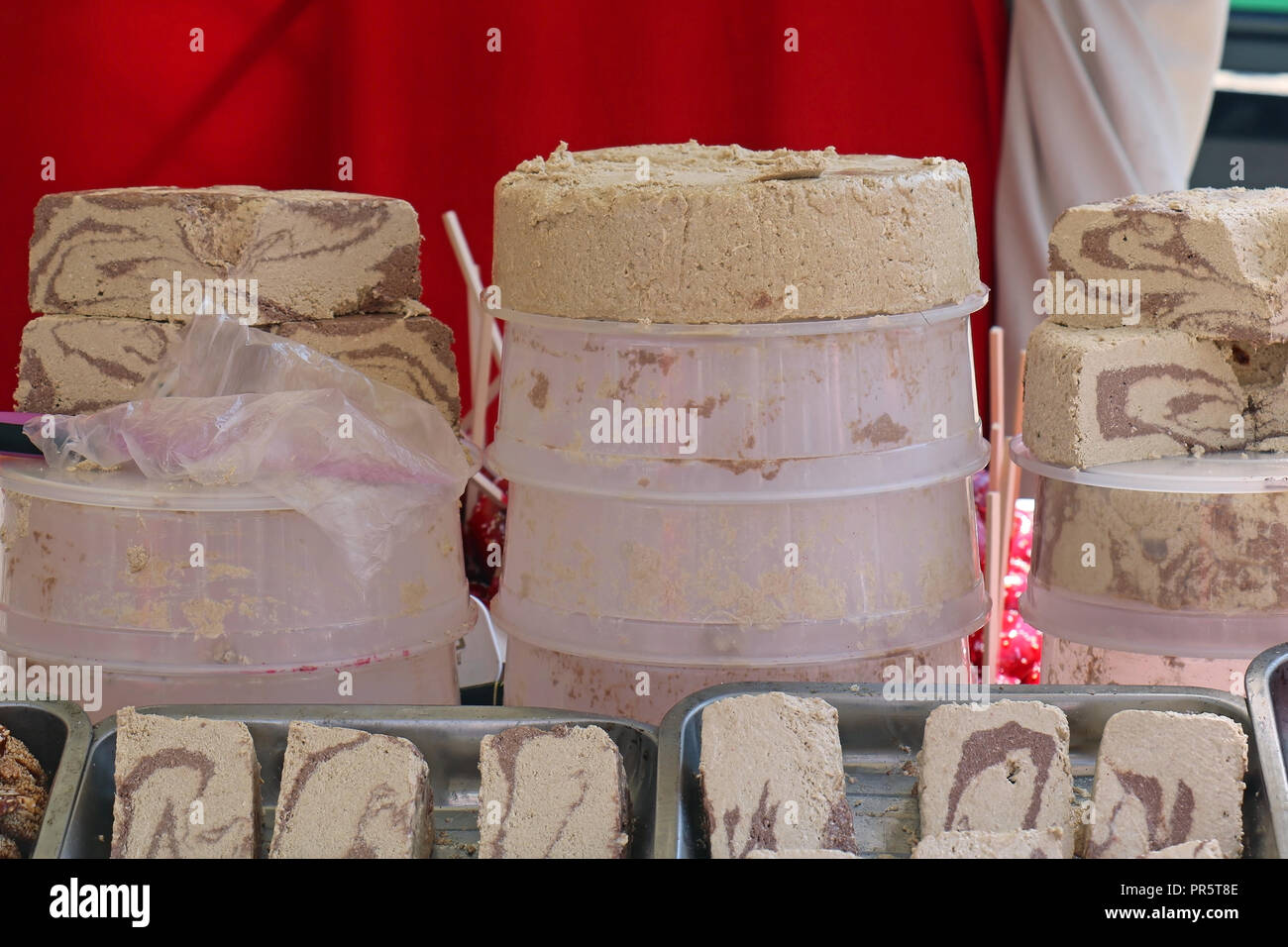 Food stand on agricultural fair selling traditional halva sweets - Stock Image