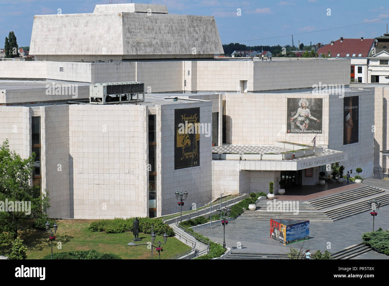Serbian national theatre building entrance in Novi Sad during sunny day with posters promoting repertoire of current plays that can be seen. Stock Photo