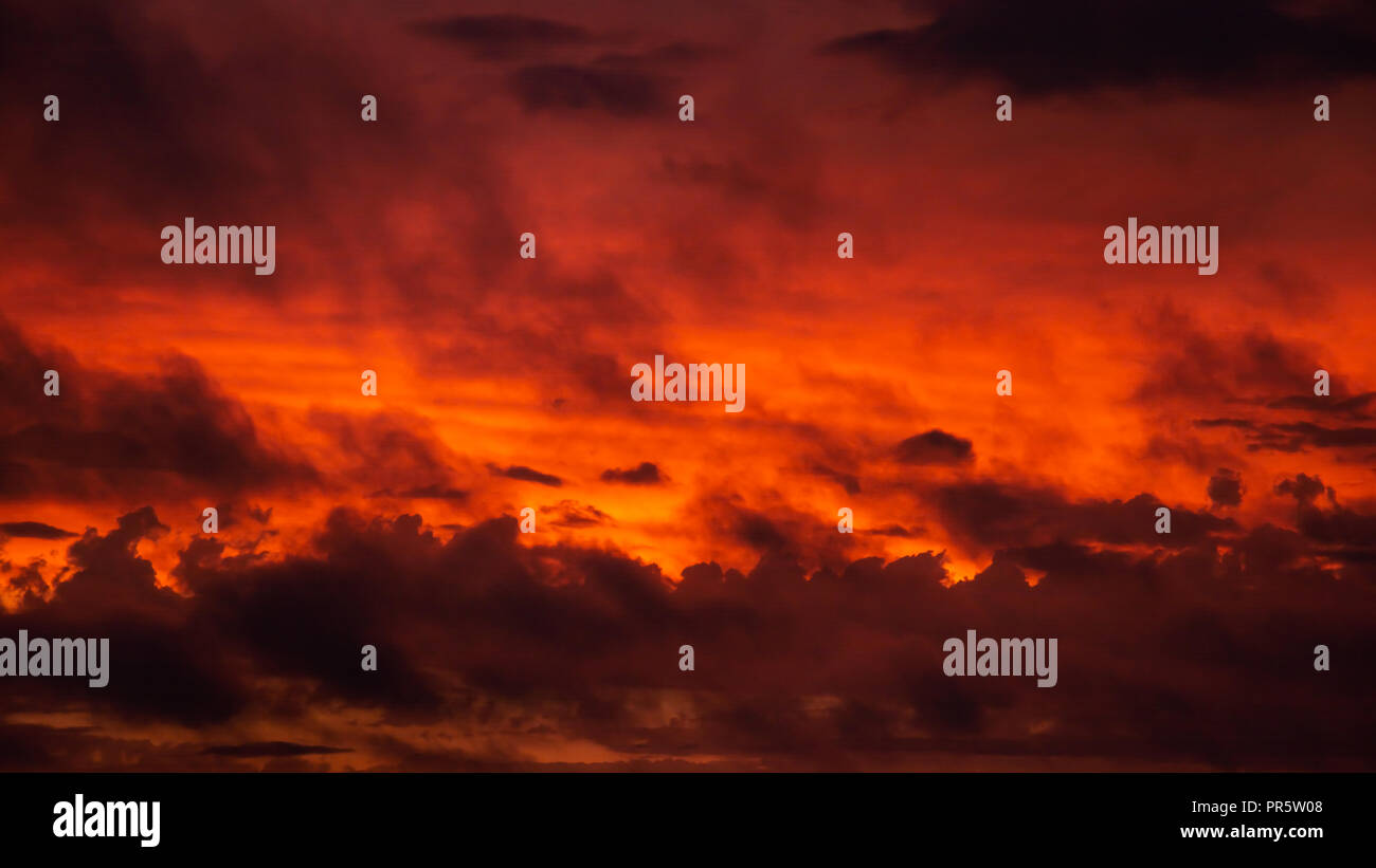 Reddish and dramatic feeling in a sunset sky - Stock Image