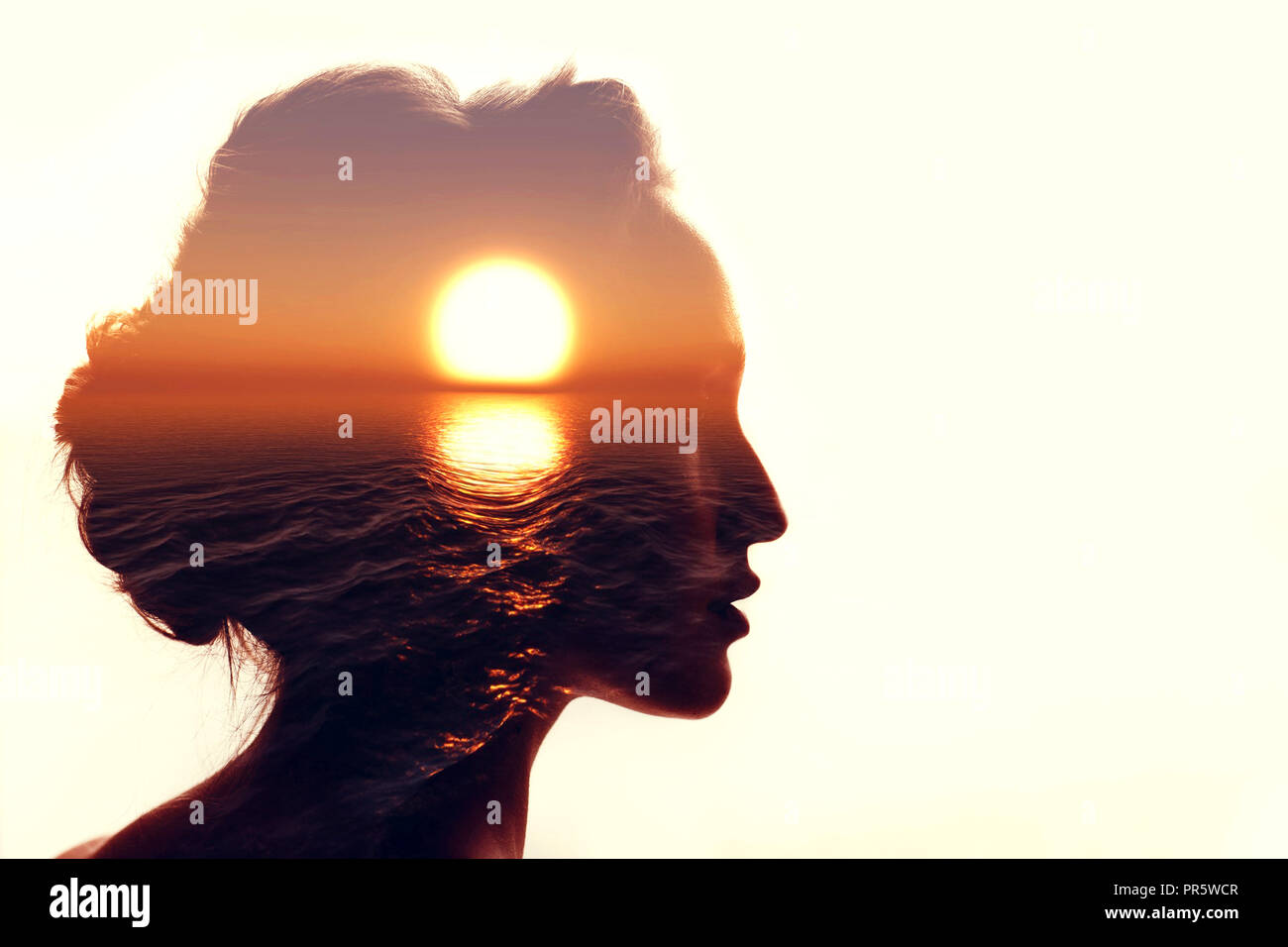 Psychology concept. Sunrise and woman silhouette. Stock Photo
