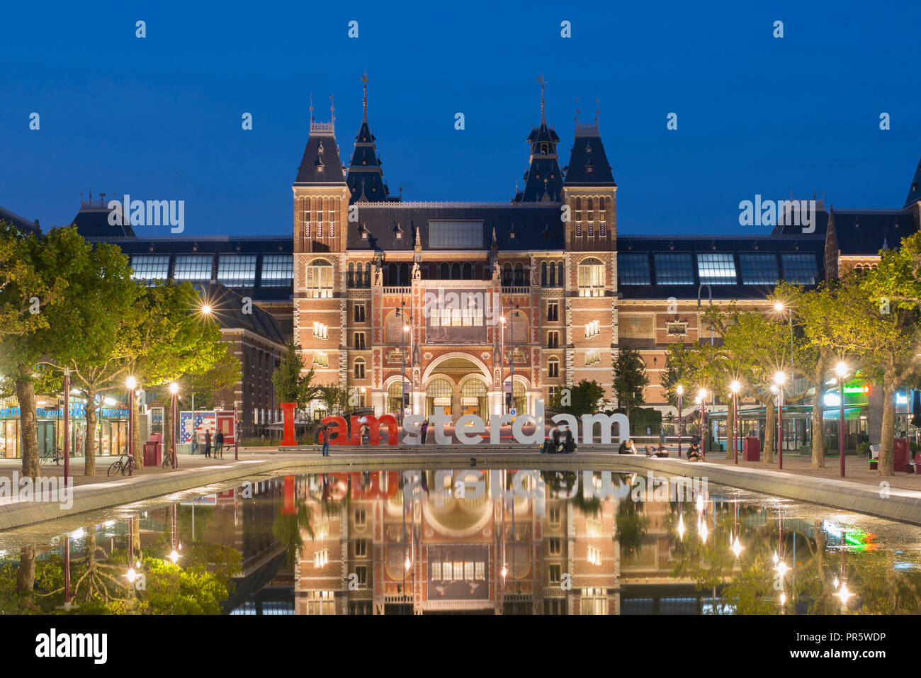 "Rijksmuseum Amsterdam, Netherlands, with paintings of Rembrandt (for example ""Night Watch"") on square Museumplein. Architect Pierre Cuypers. Stock Photo"