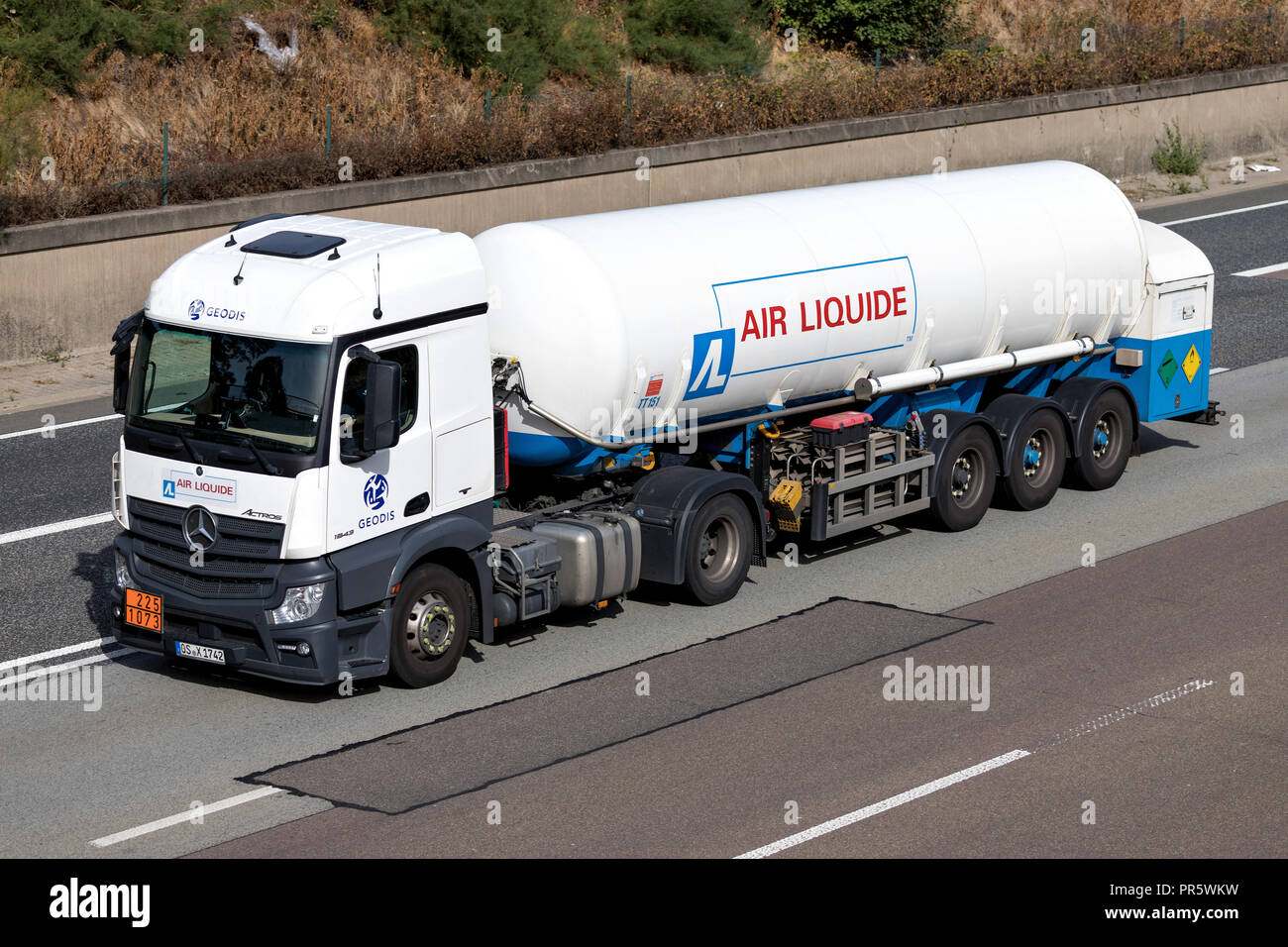 Air Liquide truck on motorway. Air Liquide is a French multinational company which supplies industrial gases and services to various industries. - Stock Image
