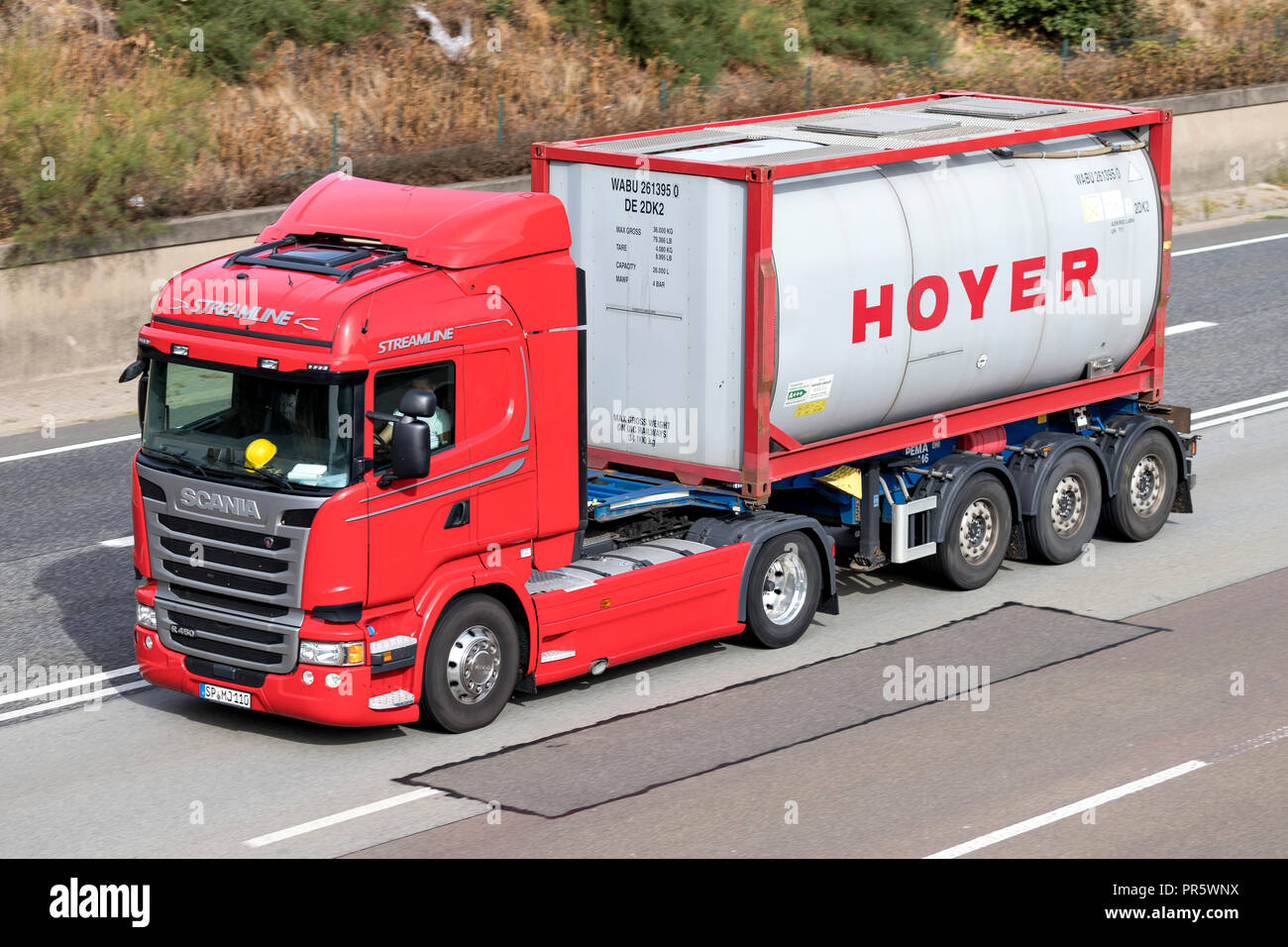 Hoyer truck on motorway. Hoyer is a global market leader for transports of liquid goods by road, rail and sea. - Stock Image
