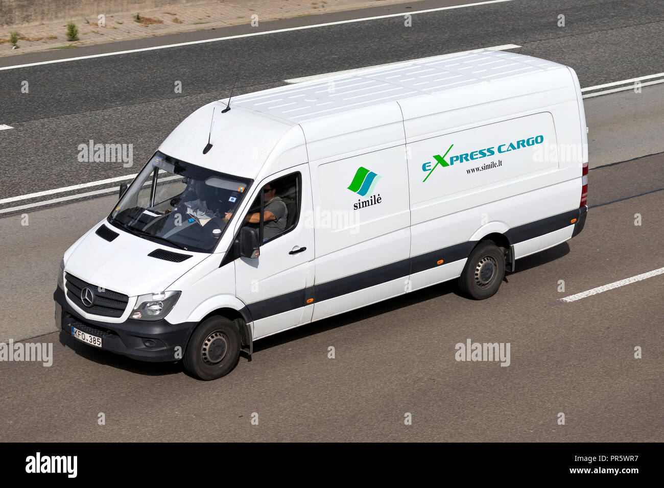 Simile van on motorway. Simile UAB offers express cargo door-to-door delivery, transportation and logistics services using vehicles up to 3.5 tons. - Stock Image