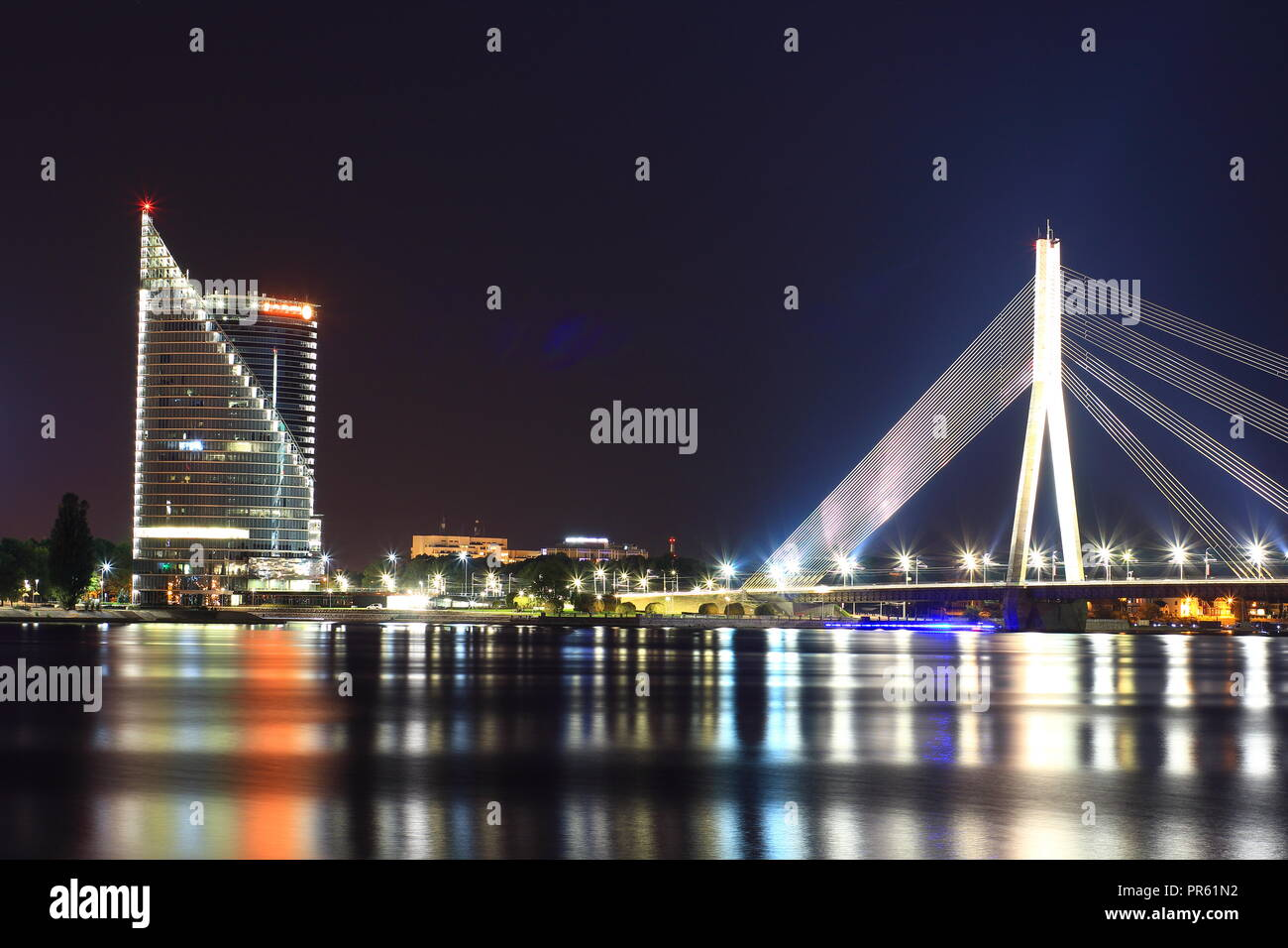 Vansu Bridge that crosses the river Daugava in Riga, the capital of Latvia. Latvians celebrates its 100 years of independence throughout the year 2018 - Stock Image