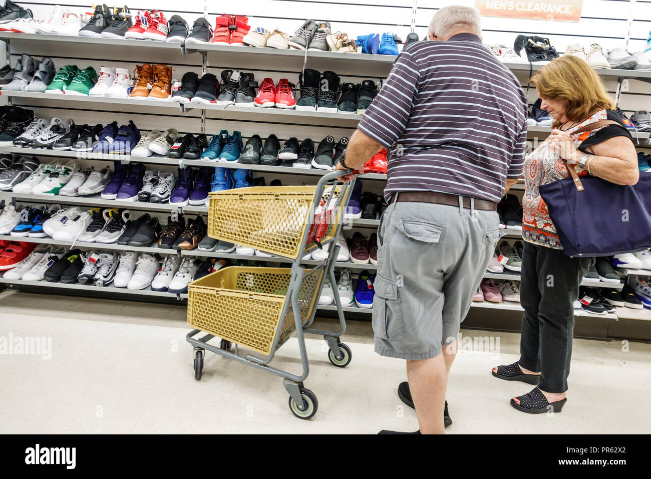 Miami Florida Kendall The Palms at Town & Country Mall Marshalls discount department store inside shopping shoes men's athletic man woman couple looki Stock Photo