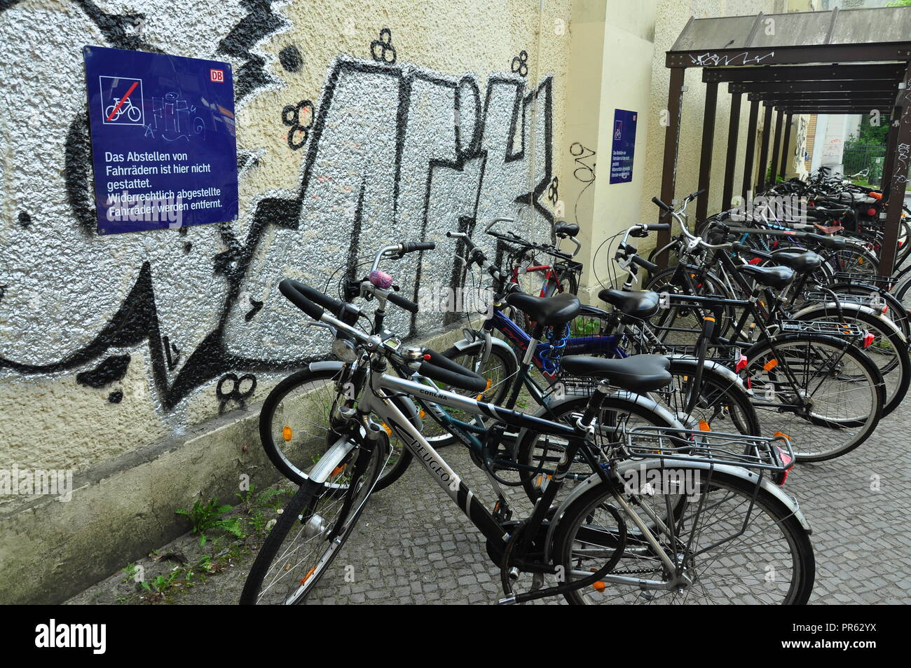 Some violation of rules in Germany. Parked bikes in a forbidden zone. - Stock Image