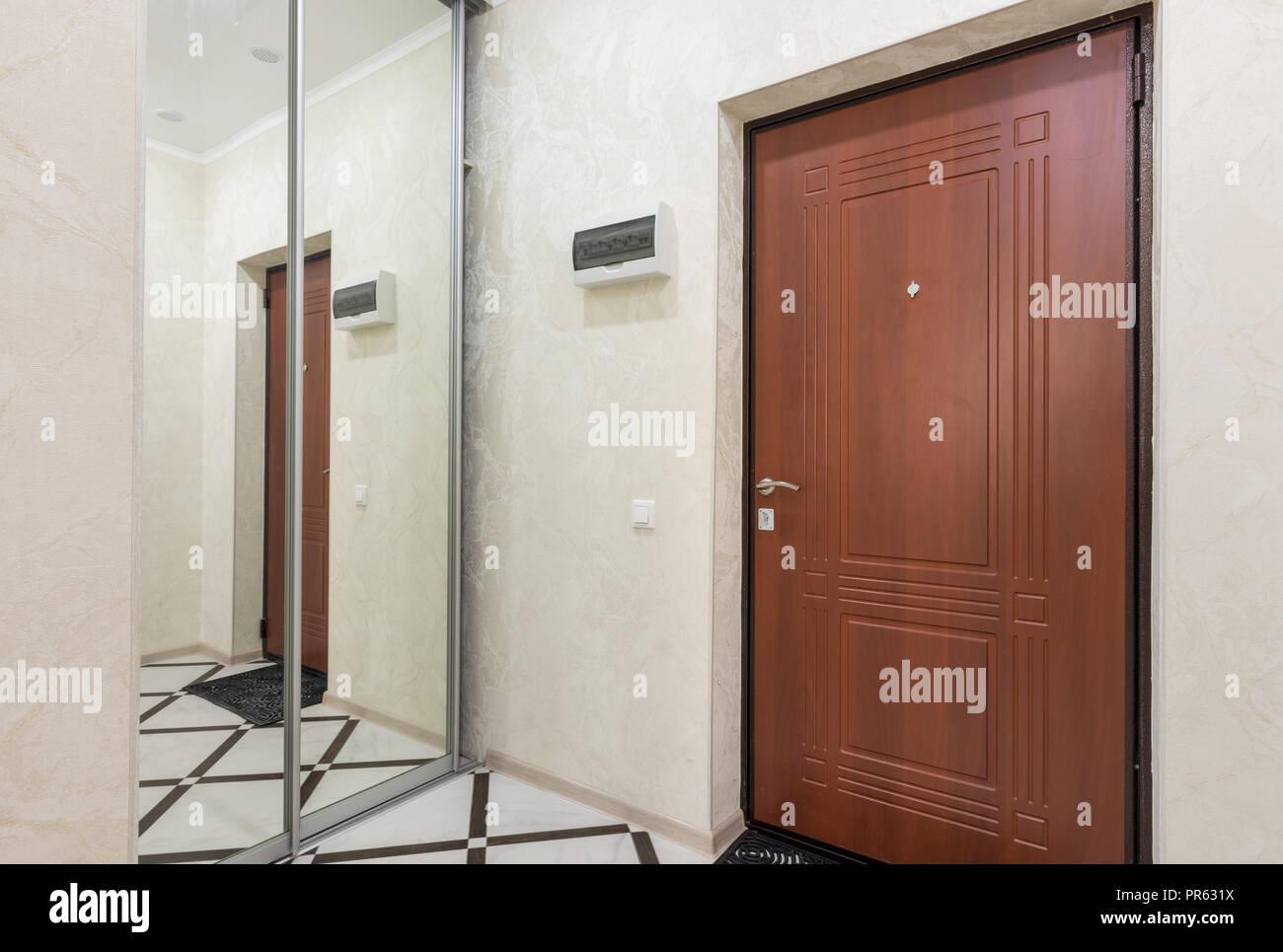 Sliding Wardrobe In The Hallway Of A Small Apartment Stock