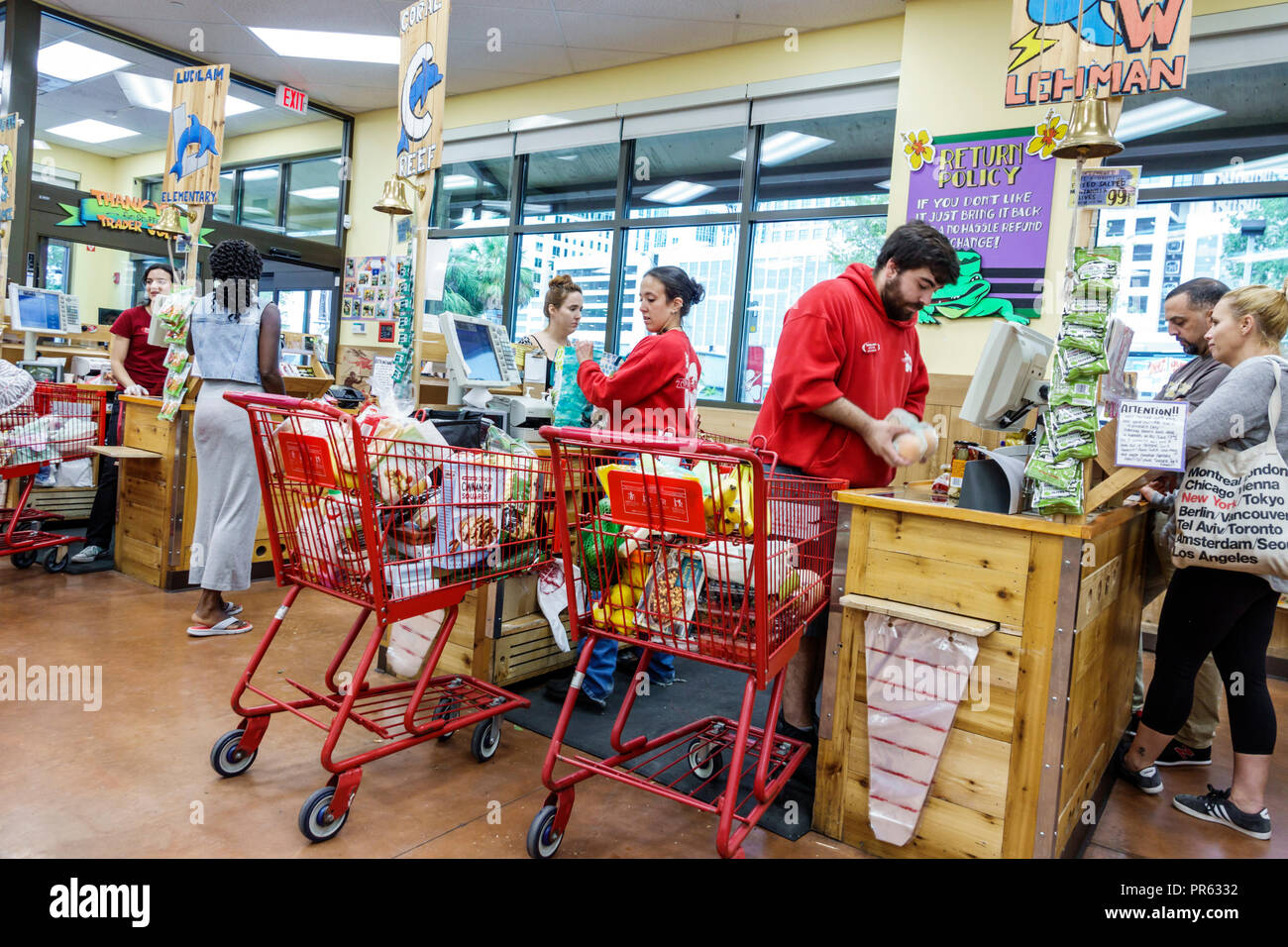 Miami Florida Trader Joe's supermarket grocery store food inside shopping checkout line queue cashier man woman cart trolley - Stock Image