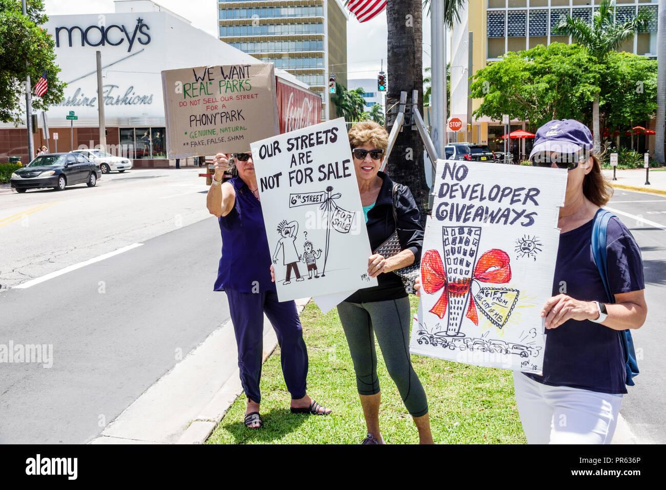 Miami Beach Florida protest developers development residents woman - Stock Image