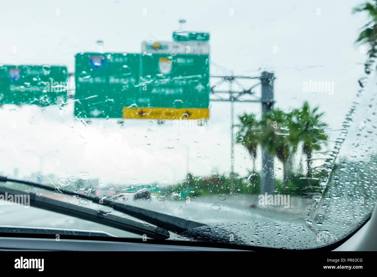 Miami Florida Palmetto Expressway driving rain rainy raining automobile car window windshield view highway interstate - Stock Image